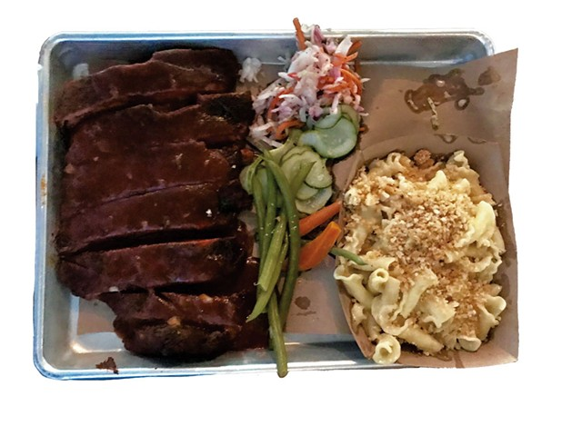 Pork ribs meal slathered in smoky barbecue at Black Diamond Barbeque - SALLY POLLAK