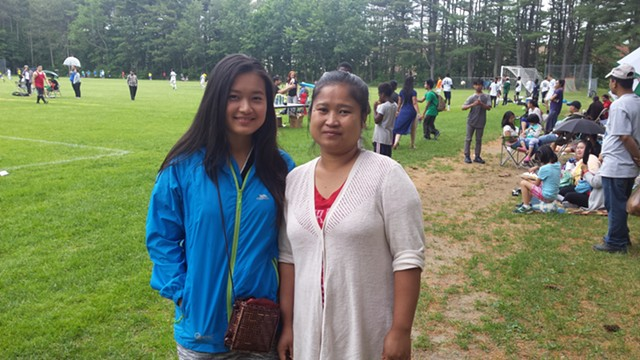 Interpreter Poe Poh (left) and Thaw Theet at Leddy Park in Burlington - KYMELYA SARI