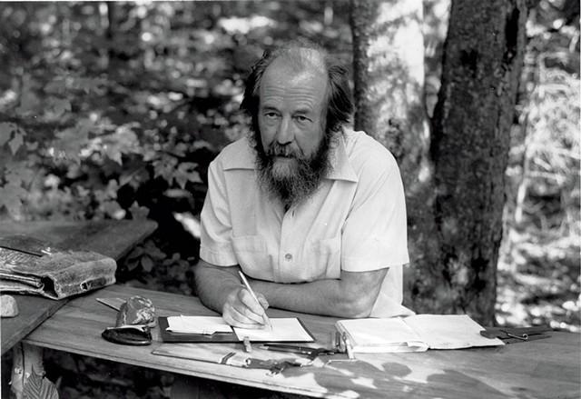 Solzhenitsyn in Cavendish, at his self-made table with birch legs. - COURTESY OF THE ALEKSANDR SOLZHENITSYN CENTER.