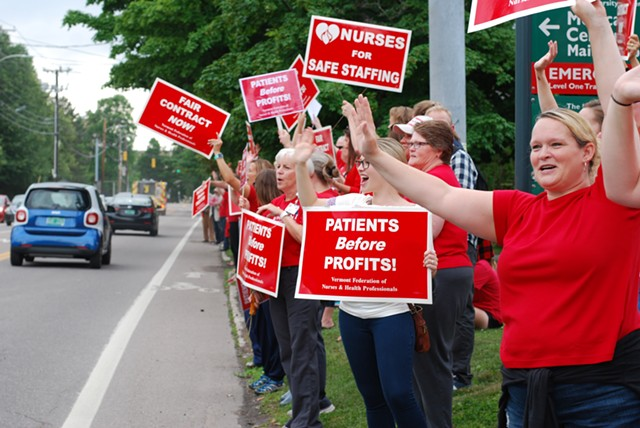 An ambulance, a firetruck and a police car were among the automobiles that honked support for the nurses Thursday. - SARA TABIN