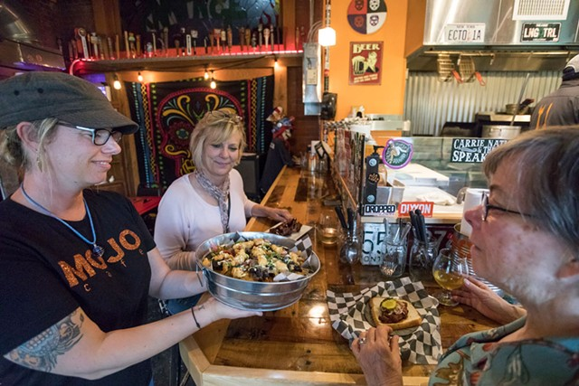Mojo Café owner Jodi Seward serving local customers Pam McLaughlin and Leanne Jewett lobster nachos - TOM MCNEILL