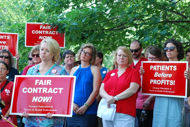 Union members and supporters at a press conference Monday morning announcing the strike notice - SARA TABIN