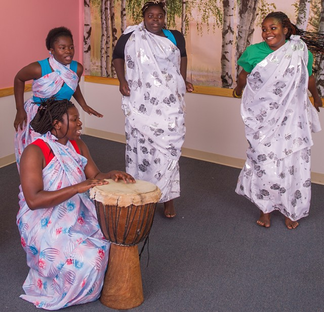 Aline Mukiza (with drum) and Burundian dancers - COURTESY OF JEFF WOODWARD