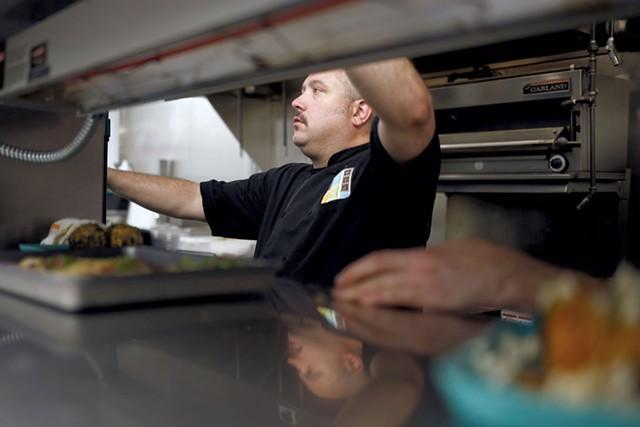 Chef Dennis Marcoux in the kitchen - SARAH PRIESTAP