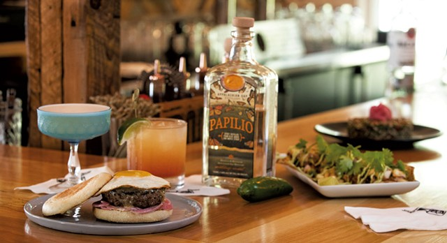 Amy's Wild Hart cocktail, Spicy Paloma Sunrise cocktail, P&T Burger, cajun shrimp tacos, and pearl pesto couscous - JAMES BUCK