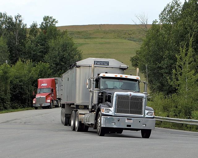 Trucks leaving Coventry landfill - MOLLY WALSH
