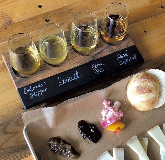 Eden Specialty Ciders flight with cheese - COURTESY OF EDEN SPECIALTY CIDERS
