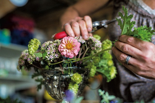 Diane Doll preparing an assortment of fresh-cut flowers at Stray Cat Flower Farm in Burlington - GLENN RUSSELL