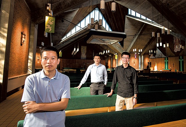 From left: Giang Vu, Thang Nguyen and Luan Tran at the Chapel of St. Michael the Archangel on the campus of Saint Michael's College - GLENN RUSSELL