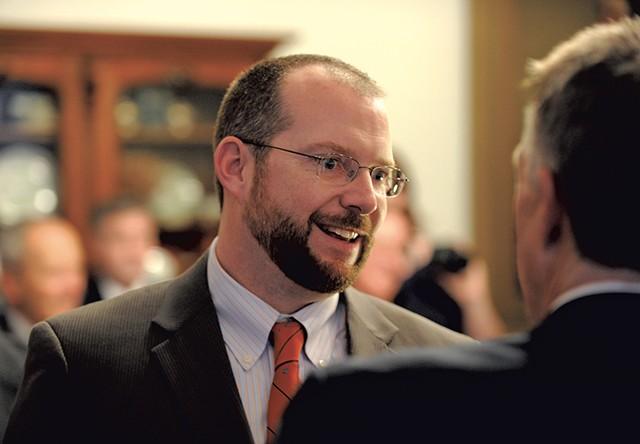Jason Gibbs talking with Gov. Phil Scott - FILE: JEB WALLACE-BRODEUR