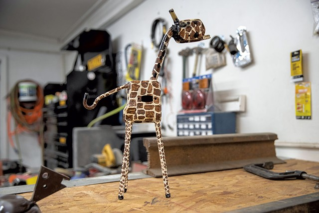 One of LaRock's metal creations, a miniature of the giraffe that stands outside his South Burlington auto-body shop - JAMES BUCK