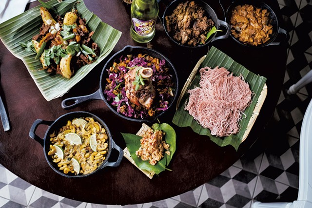 An assortment of dishes, including Welcome to Jaffna (goat curry), Kandy Man (pork curry), string hoppers, red coconut sambol, Ella's Garden (cashew curry), deviled beef and kottu roti with lamb - COURTESY OF NAMA | MICHAEL VESIA