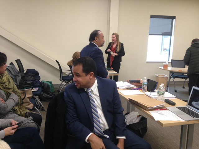 Mario Macias turns to speak with family members at Friday's hearing. His lawyer, Francisco Guzman, stands in the background. - MOLLY WALSH