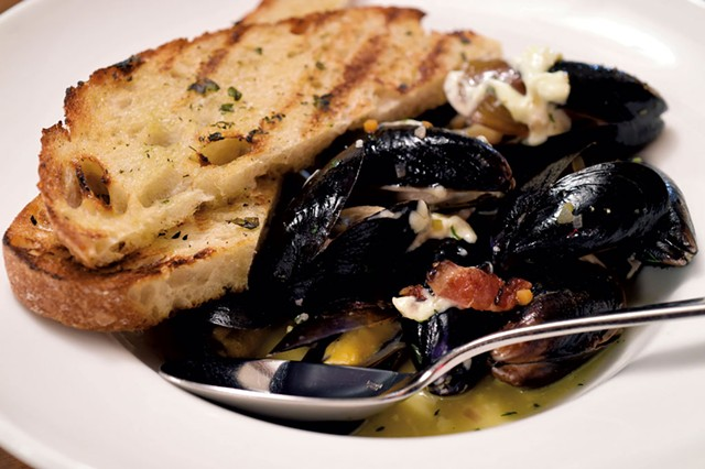 Cider-steamed mussels with grilled bread, smoked bacon and aioli - JEB WALLACE-BRODEUR