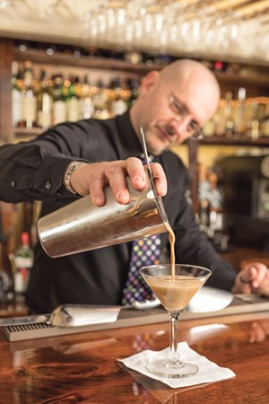 Head server Thomas Meek makes an Espresso Martini. - OLIVER PARINI
