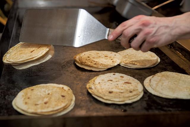 Preparing tortillas on the grill - JAMES BUCK