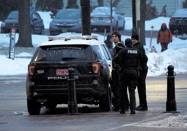 Good Times owner Derek Spilman being detained by Burlington Police - PAUL HEINTZ