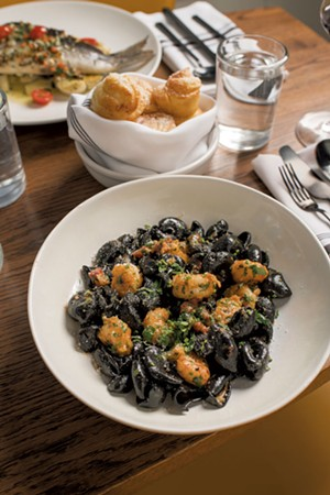 Squid-ink orecchiette with pan-fried rock shrimp, Calabrian salami and chile - CALEB KENNA