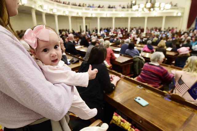 An observer and her baby at the Statehouse Wednesday - JEB WALLACE-BRODEUR