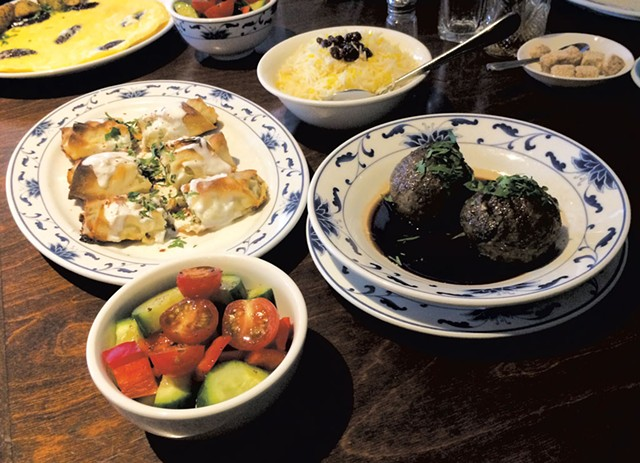 Clockwise from top: basmati rice with barberries, koufteh, salad, Persian borek and a firdaus omelette at Rumi - MOLLY ZAPP