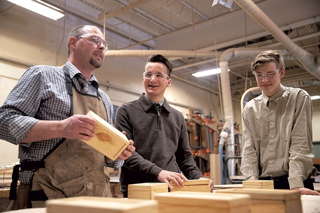 Woodworking teacher and wrestling coach Matthew Stark (left) with Majd Alabas (middle) and classmate - JAMES BUCK