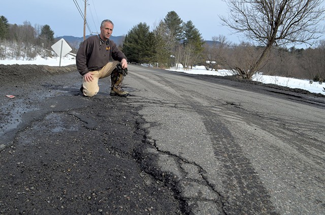Chris Viens surveying the poor condition of Guptil Road near his Waterbury home - KEVIN MCCALLUM