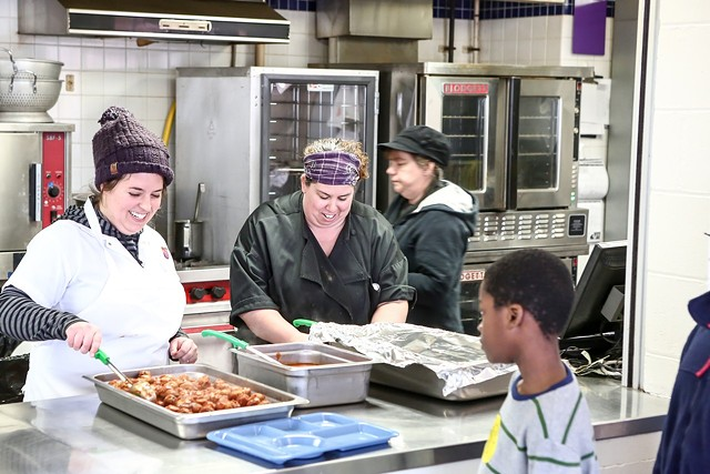 Chef Jaclyn Major of Butch + Babe's scoops meatballs in the IAA cafeteria - COURTESY OF BURLINGTON SCHOOL DISTRICT