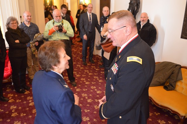 Col. Greg Knight speaks to retired colonel Rosanne Greco after  his election as the state's new adjutant general. - KEVIN MCCALLUM
