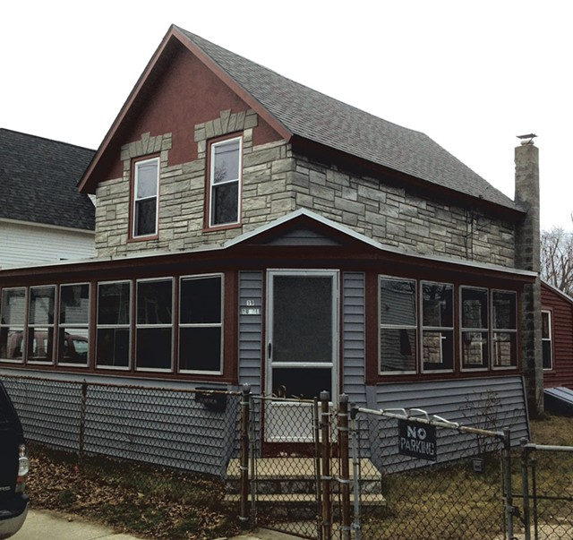 March 2013: When purchased, the circa-1913 house had concrete siding and an enclosed porch. A chain-link fence ran the border of its property. - COURTESY OF GRAHAM MACHARG
