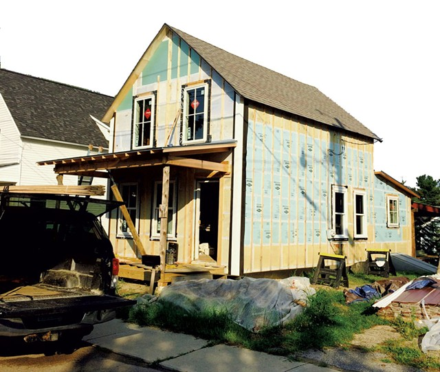 July 2015: The house is completely reframed and has new windows and doors. Exterior insulation is done. Trim is going on, and the house is nearly ready for siding. - COURTESY OF GRAHAM MACHARG