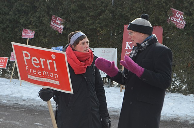 Curt McCormack discusses transportation policy with Perri Freeman outside the Sustainability Academy - KEVIN MCCALLUM