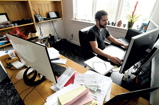 Miguel Turner working remotely from his home office in Cambridge - JEB WALLACE-BRODEUR