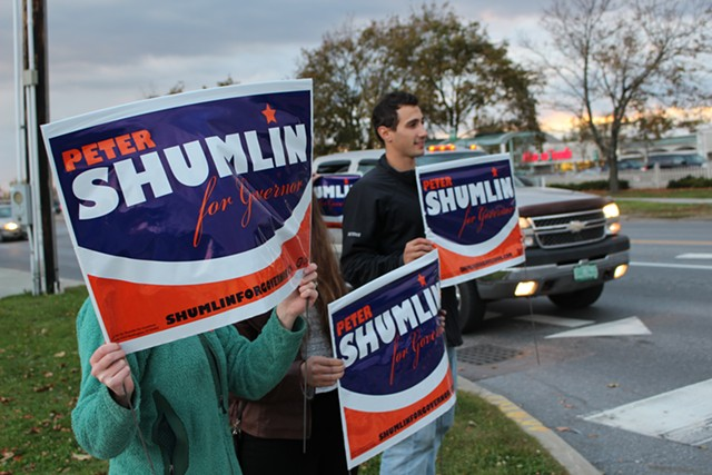 Gov. Peter Shumlin's supporters hold signs outside an October 2014 debate. - FILE: PAUL HEINTZ