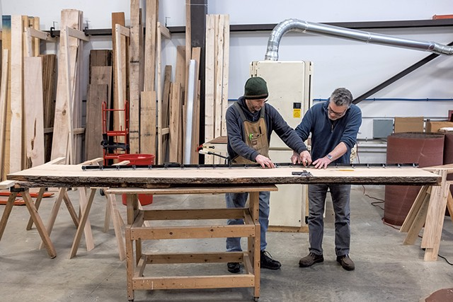 Greg Goodman and Tom Bodett working on a table at HatchSpace - ZACHARY P. STEPHENS