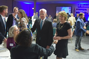 Congressman Peter Welch and his wife, Margaret Cheney, talk to Democrats at Friday night's party gathering. - TERRI HALLENBECK