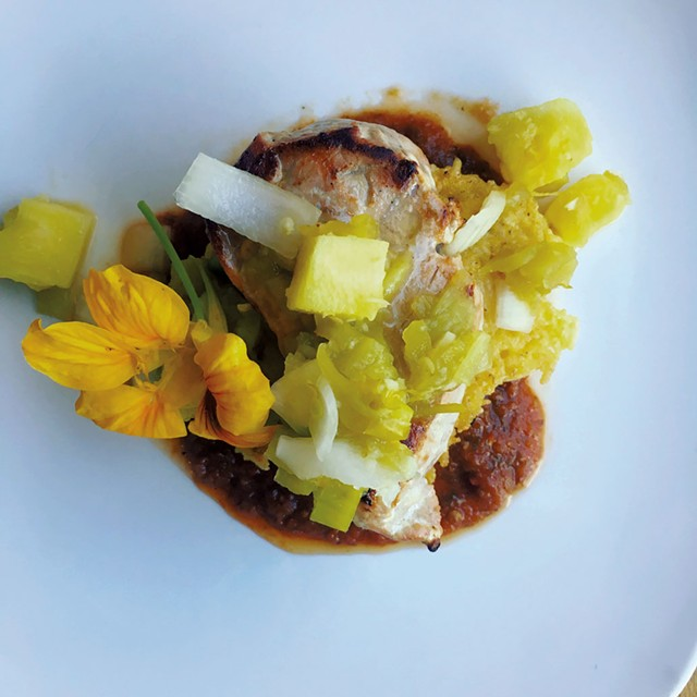 Pork chops with roasted pineapple and chipotle red pepper purée - COURTESY OF CHIP NATVIG