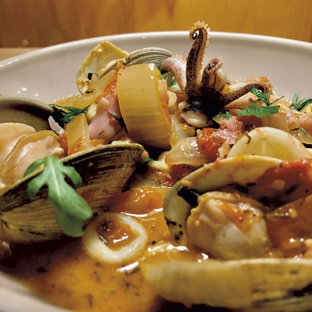 Clam sauté with squid, olives and prosciutto in tomato broth - COURTESY OF CHIP NATVIG