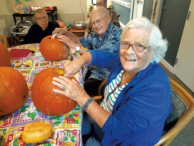 Carving pumpkins - COURTESY OF THE LIVING WELL GROUP