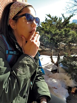 UVM student Haley Agront took a smoke break earlier this year. - MOLLY WALSH