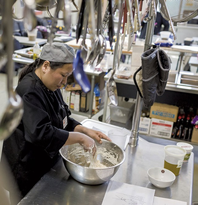 Maya Gurung-Subba mixing batter at the - Chittenden Emergency Food Shelf in Burlington - OLIVER PARINI