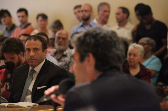 Brandon del Pozo listens as Mayor Miro Weinberger speaks. - MATTHEW THORSEN