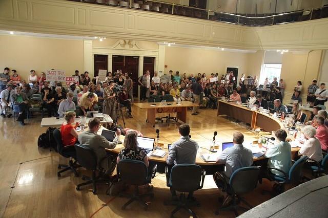 The debate drew protesters to city hall. - MATTHEW THORSEN