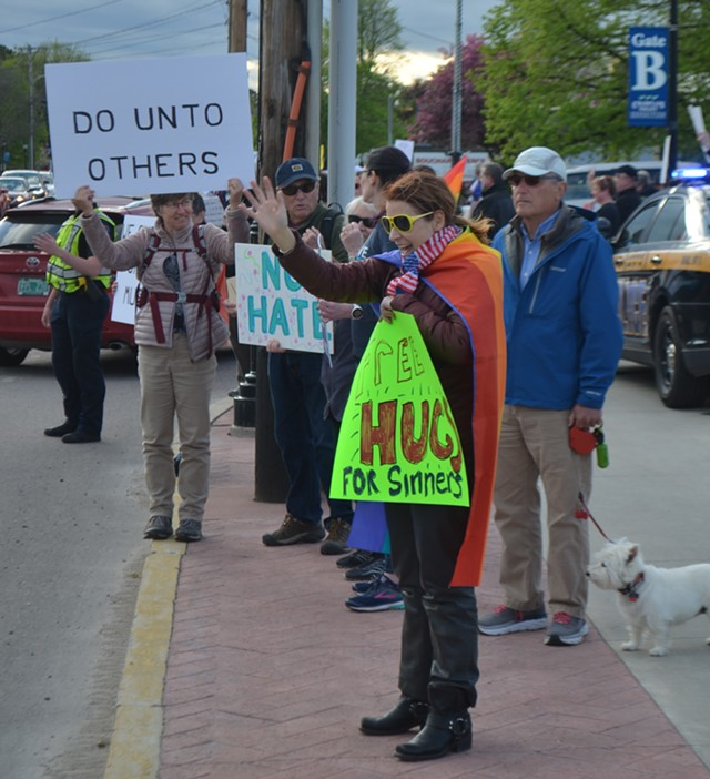 Protester Rebecca Roose outside Champlain Valley Expo - DEREK BROUWER