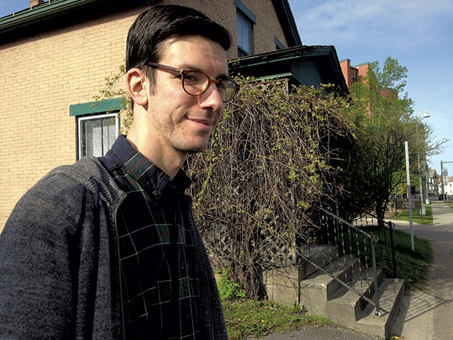 Joe Perron in front of an East Allen Street house  that could be demolished - MOLLY WALSH