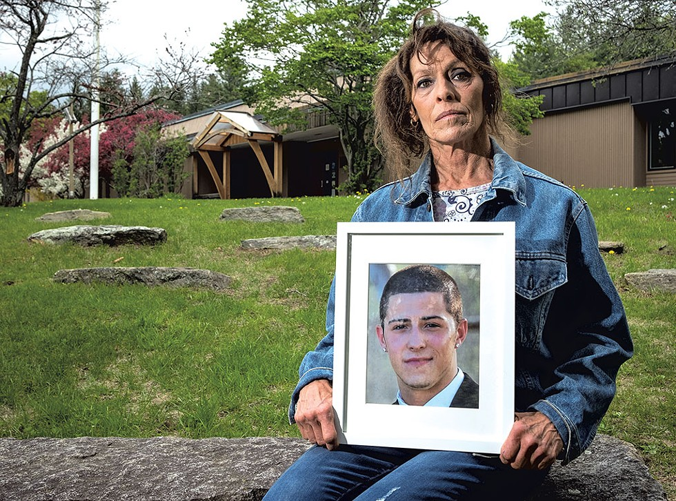 Cheryl Rusin holding a photo of her son Connor - ZACH STEPHENS