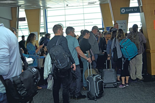 Passengers waiting to board a flight at Burlington International Airport - MOLLY WALSH