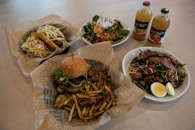 Clockwise from bottom: crispy chicken sandwich with hand-cut fries, Vermont hot dog, salmon salad, Bliss Bee sodas and a Sunrise grain bowl - DARIA BISHOP
