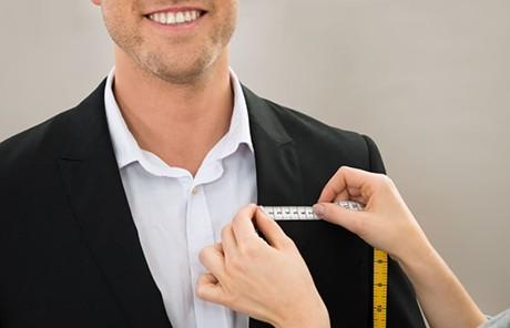 Measuring for alterations - ANDREY POPOV | DREAMSTIME.COM