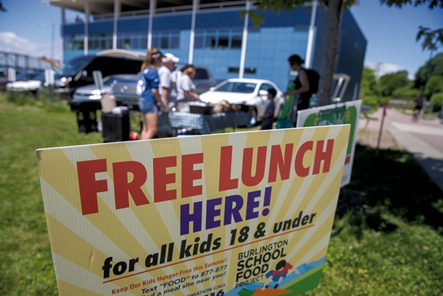 Enjoying a free lunch outside the Community Sailing Center - JAMES BUCK