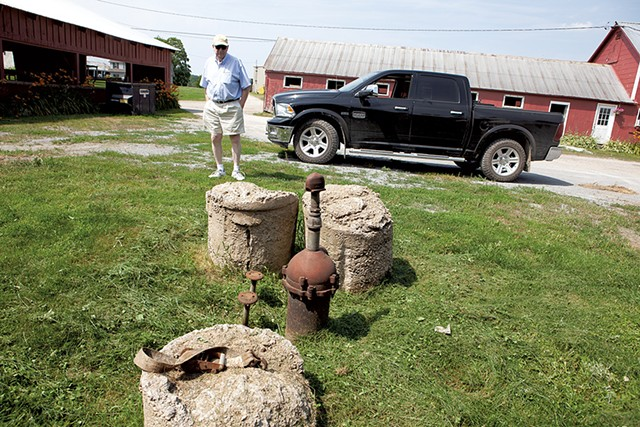 John Belter standing by the contaminated well on his South Burlington farm - KEVIN MCCALLUM